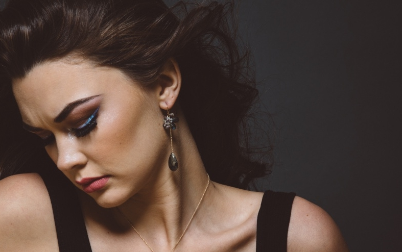 model wearing labradorite and gemstone earrings