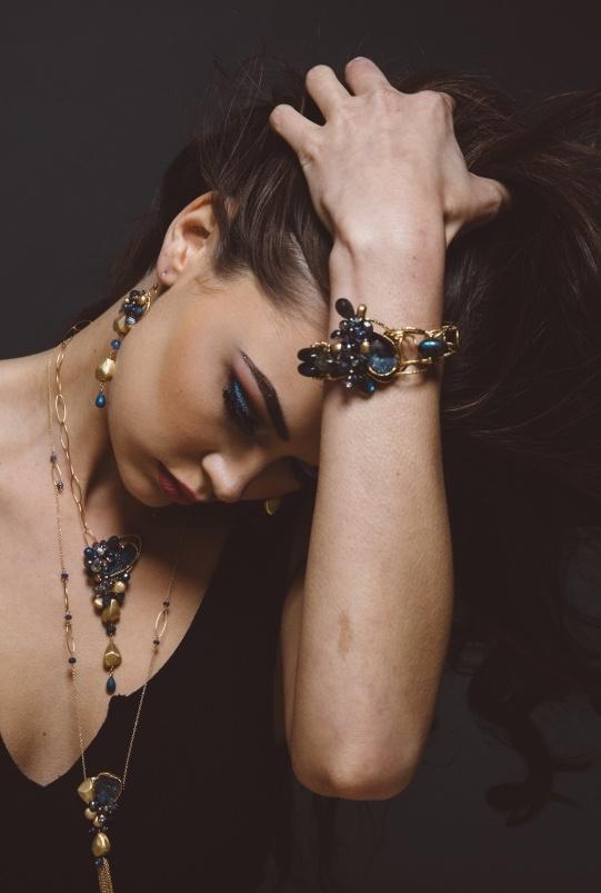 model wearing gemstone and druzy cuff bracelet