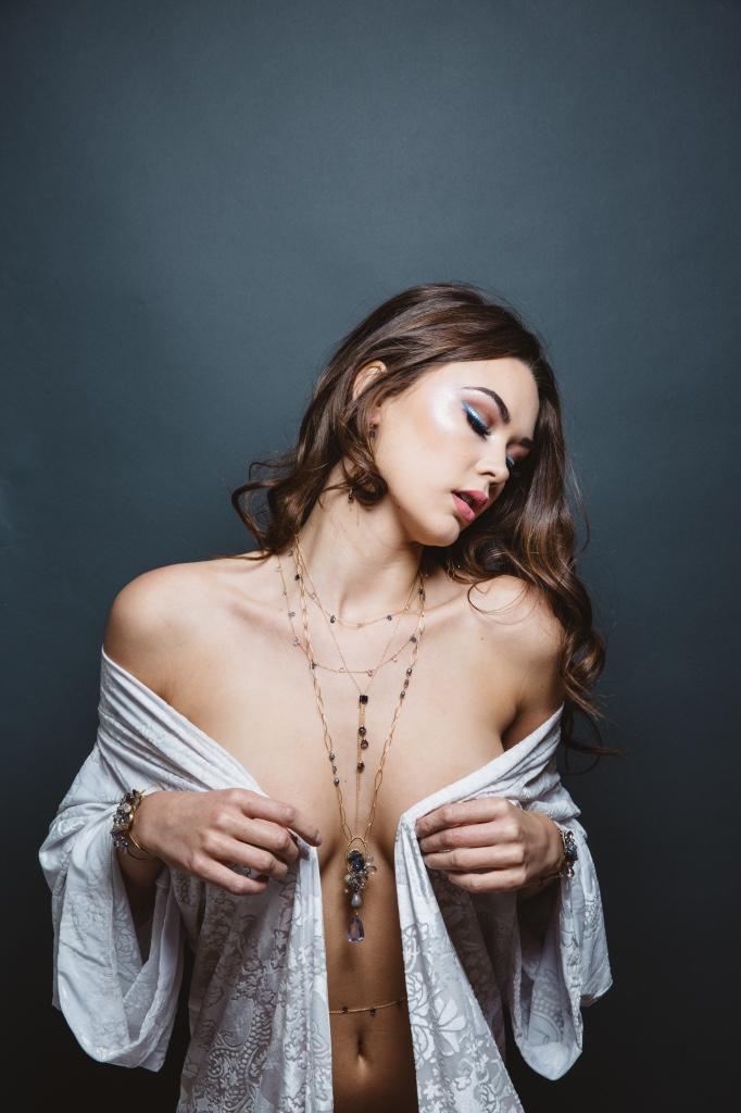model wearing gemstone pearl druzy gold long pendant necklace