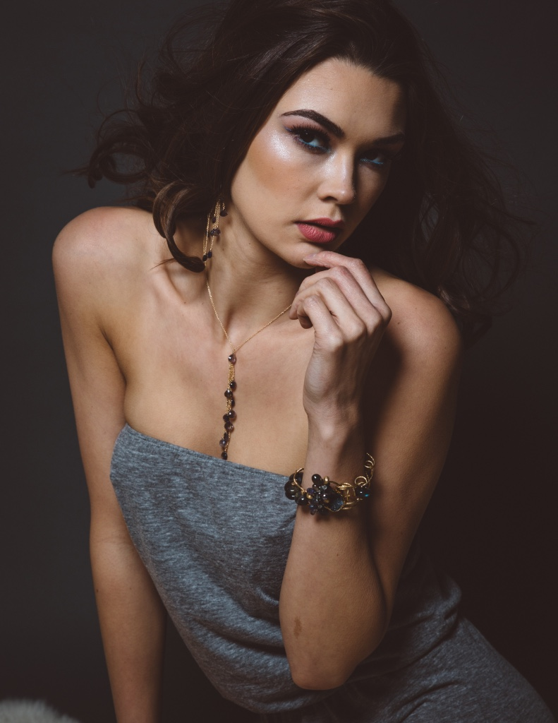 model wearing iolite multi drop necklace with gold chains