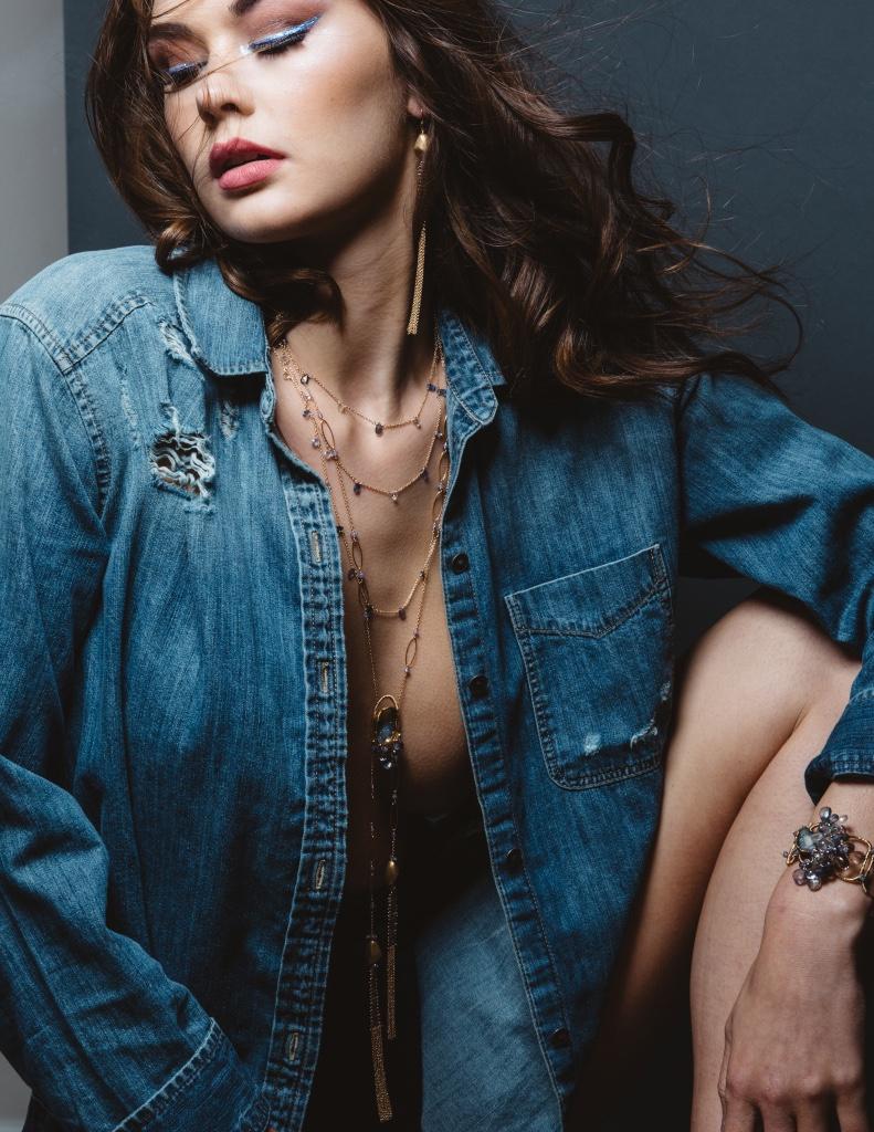 model wearing gemstone druzy double gold chain tassel long pendant necklace