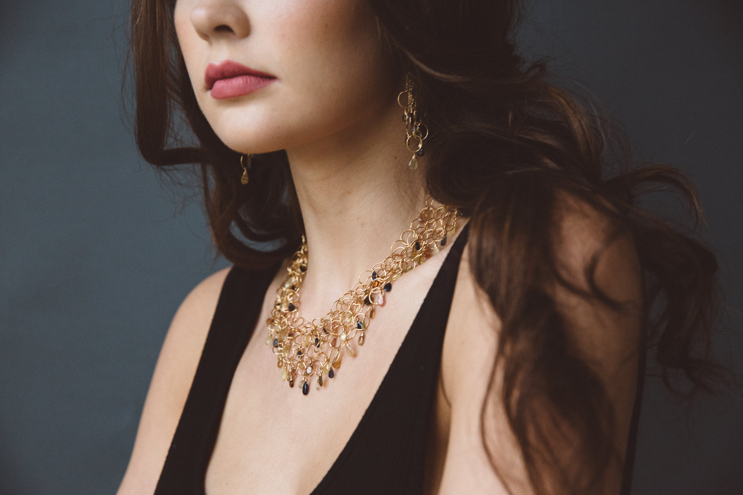 model wearing padparadscha sapphire multi layer gold link necklace