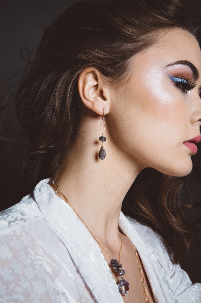 model wearing mystic labradorite pearlized moonstone gold drop earrings