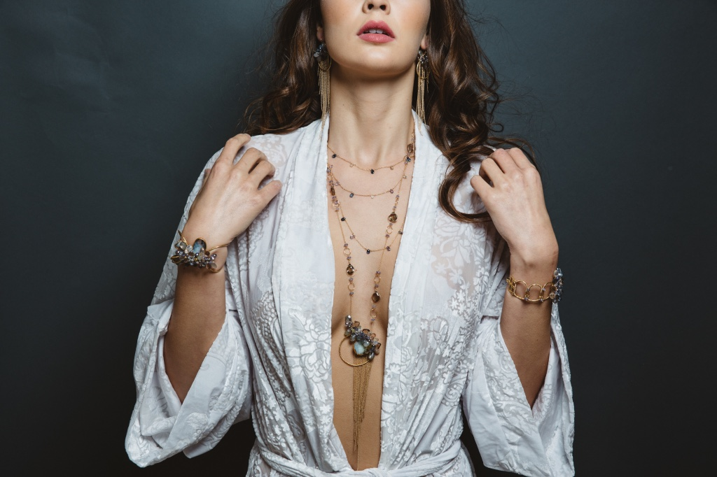 model wearing gemstone druzy pearl circle pendant with gold chain tassel long necklace