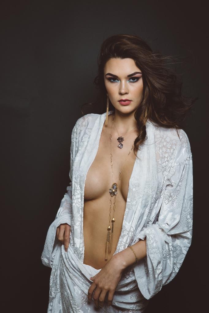 model wearing gemstone druzy double tassel chain mail tassel long necklace