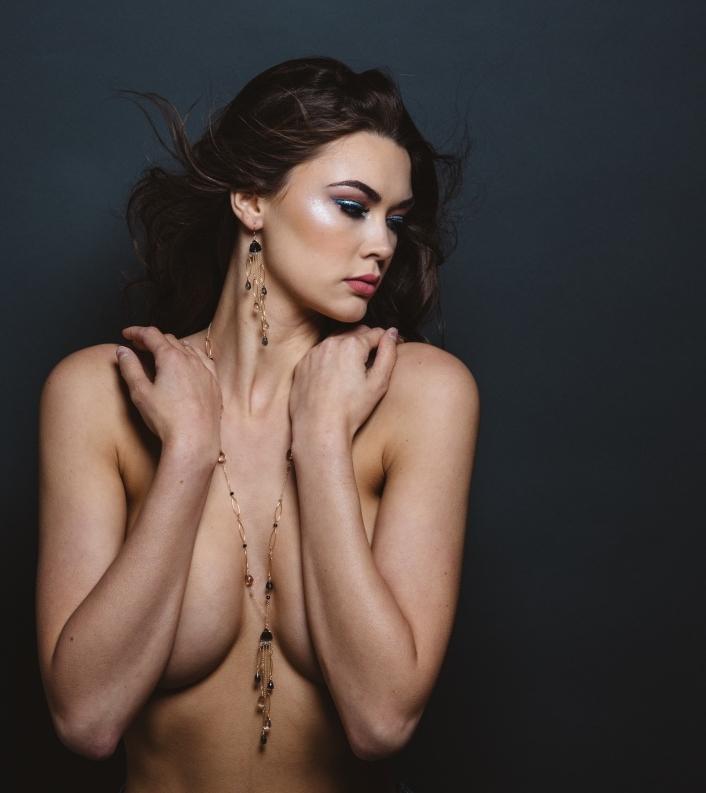 model wearing fancy trillion cut quartz multi gold chain link necklace