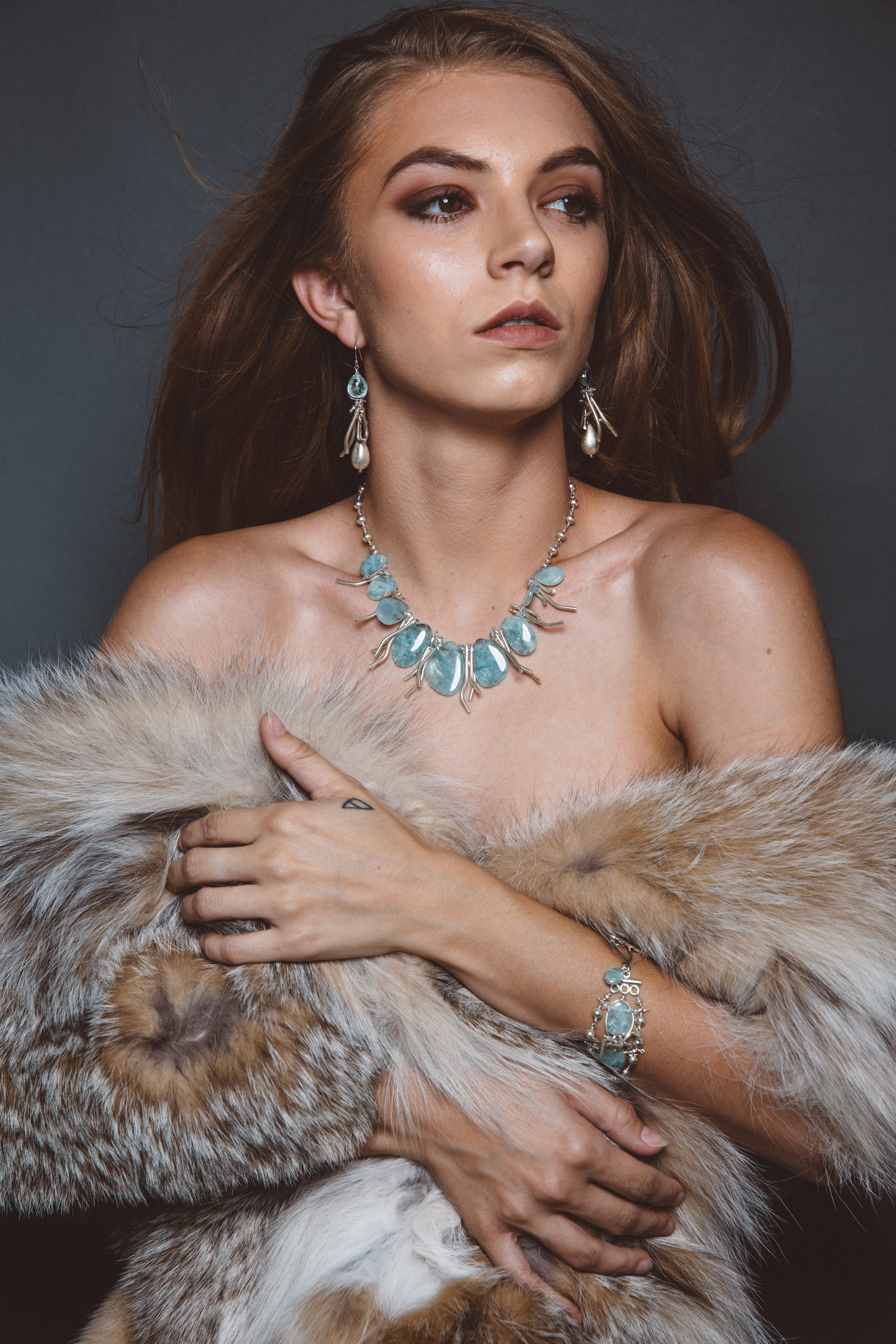 model wearing aquamarine statement collar necklace with hill tribe silver