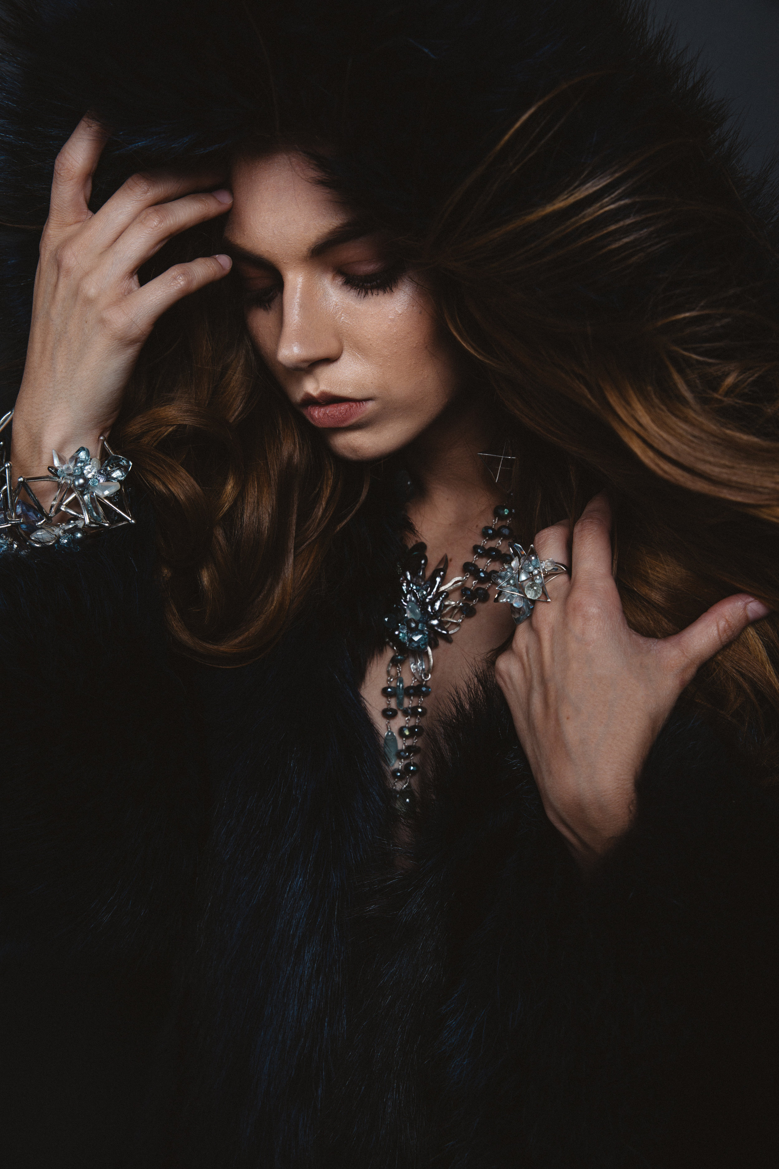 model wearing a statement gemstone necklace