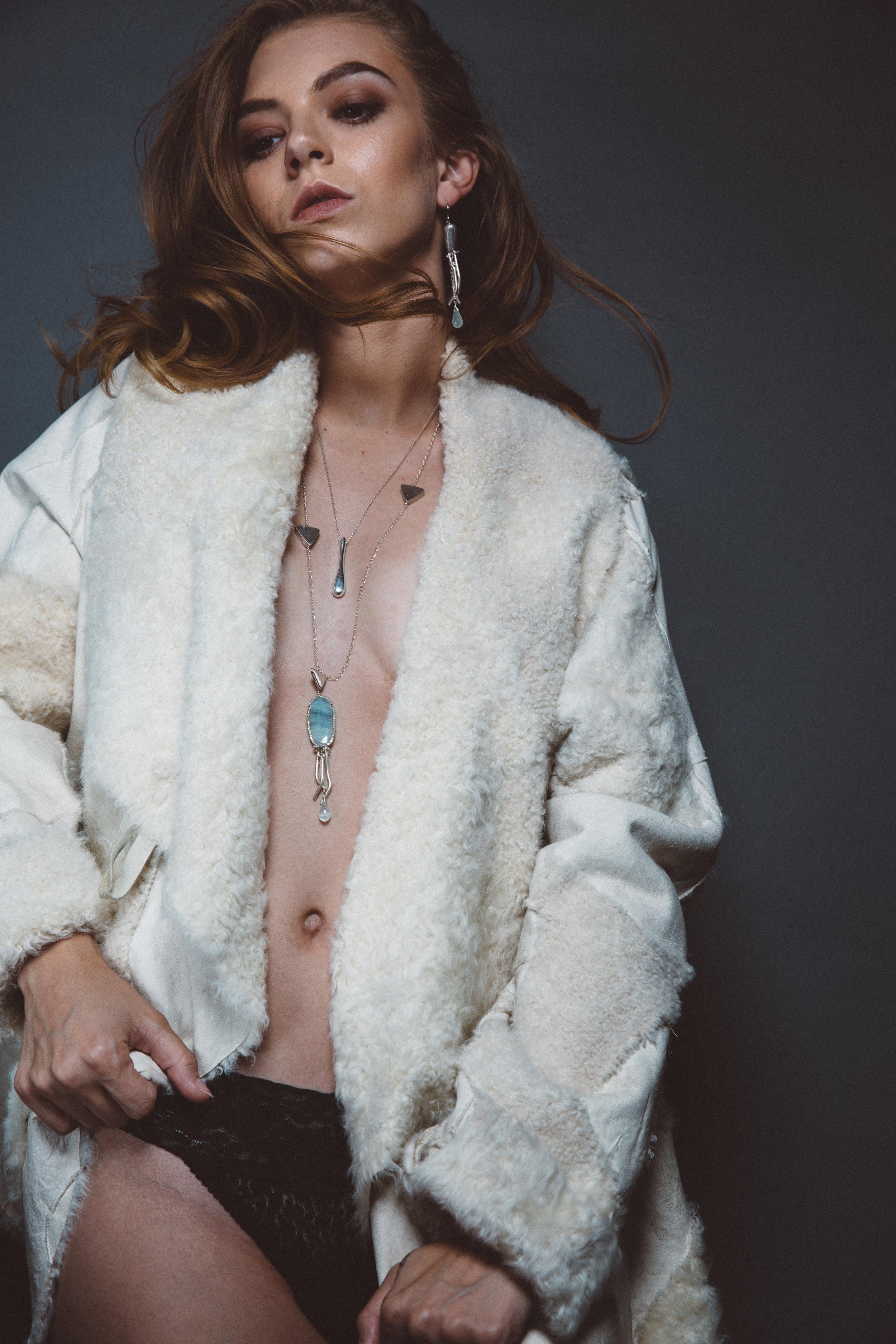 model wearing long aquamarine necklace