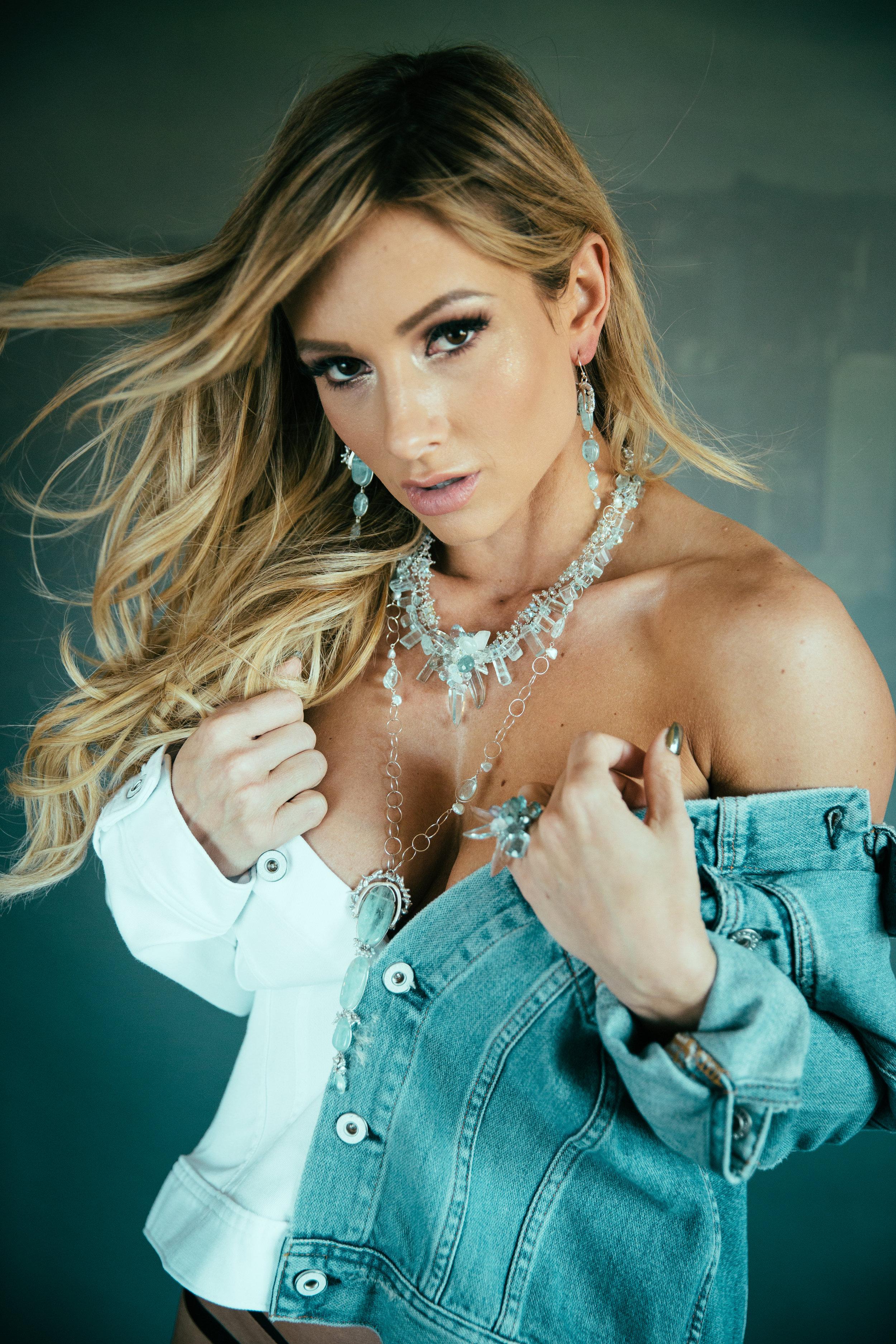 model wearing gemstone statement cocktail ring