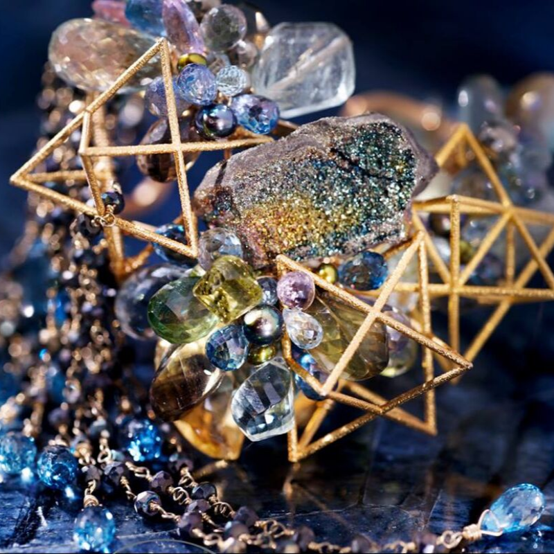 Rainbow Pyrite - Naturally occuring and rare. The most valuable shimmer with all colors of the rainbow, including gold, green, pink and blue. It is famed for its rainbow-like iridescence, caused by differential refraction and diffraction of light.