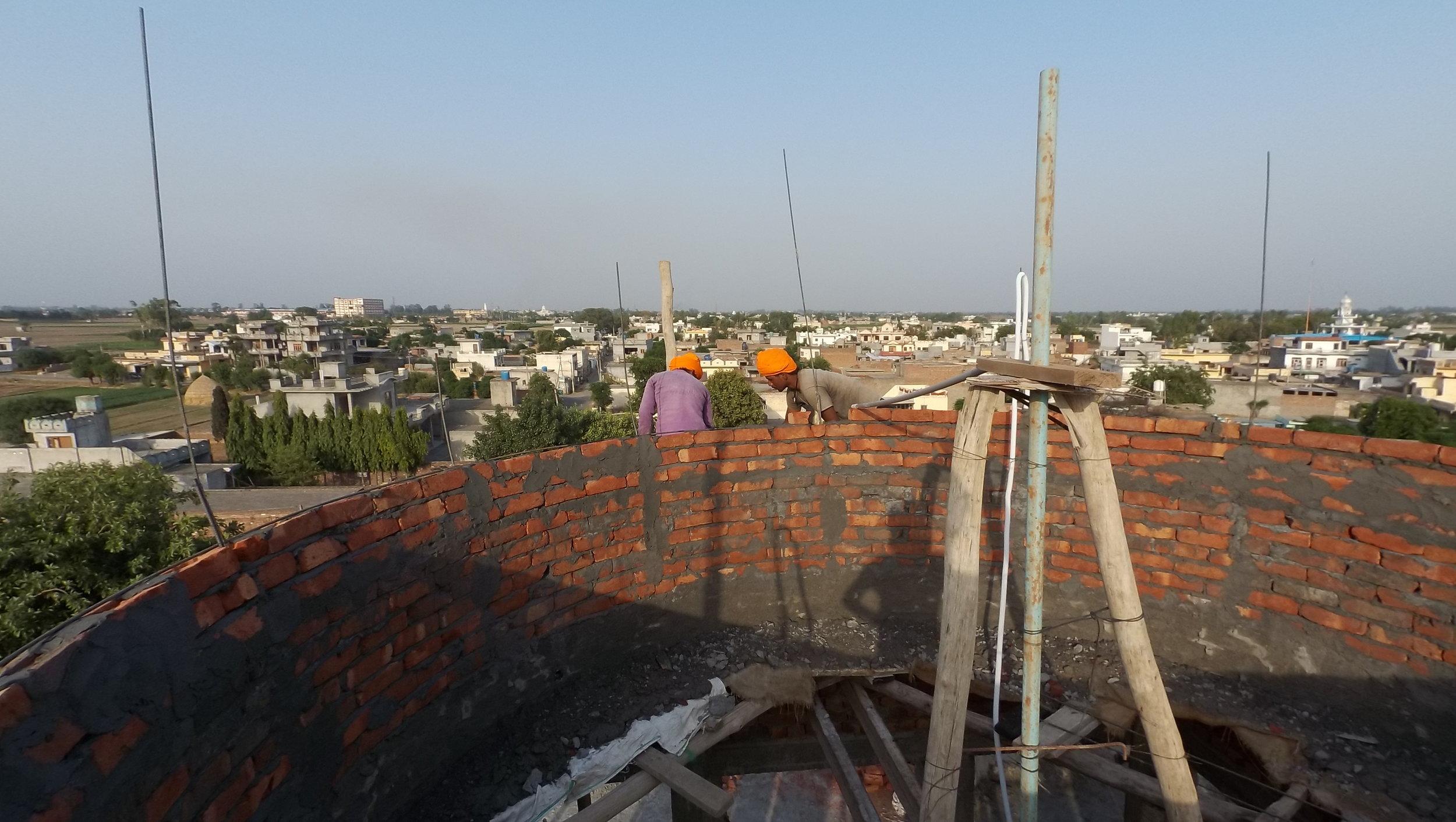 Brick-laying of a building in progress, Ludhiana, 9 June 2016