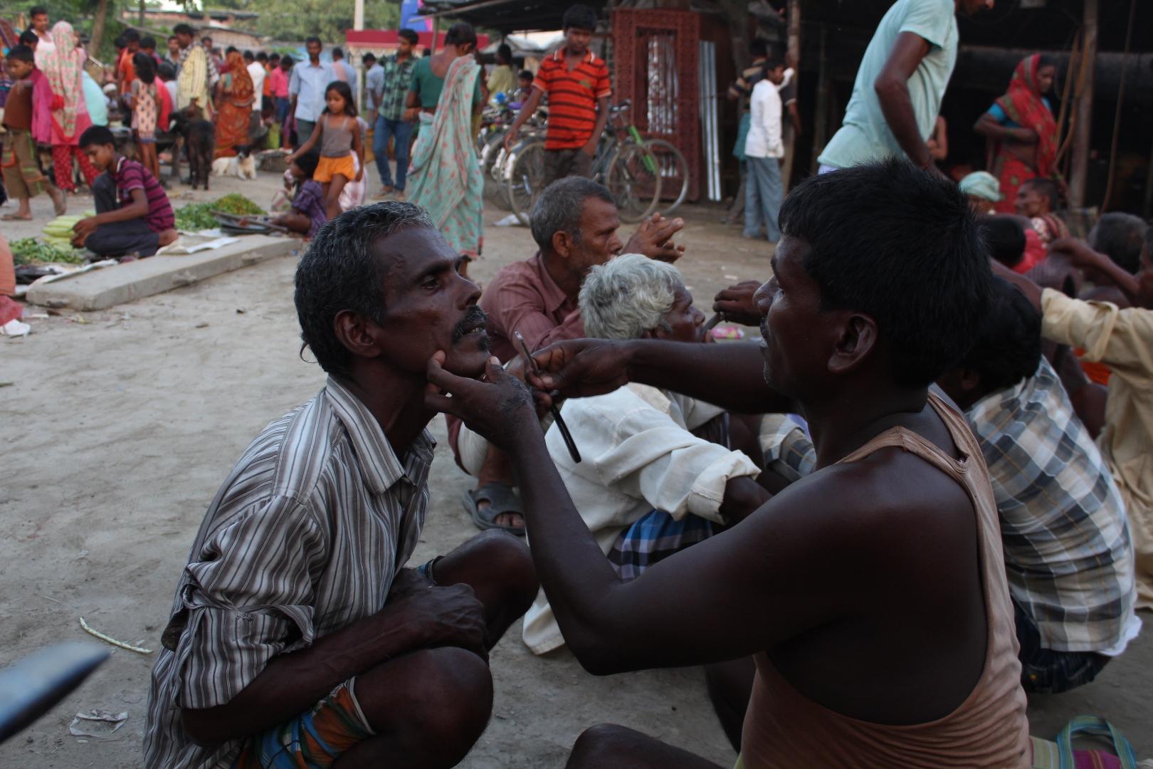 Barber grooms his client, Araria, 29 June 2016