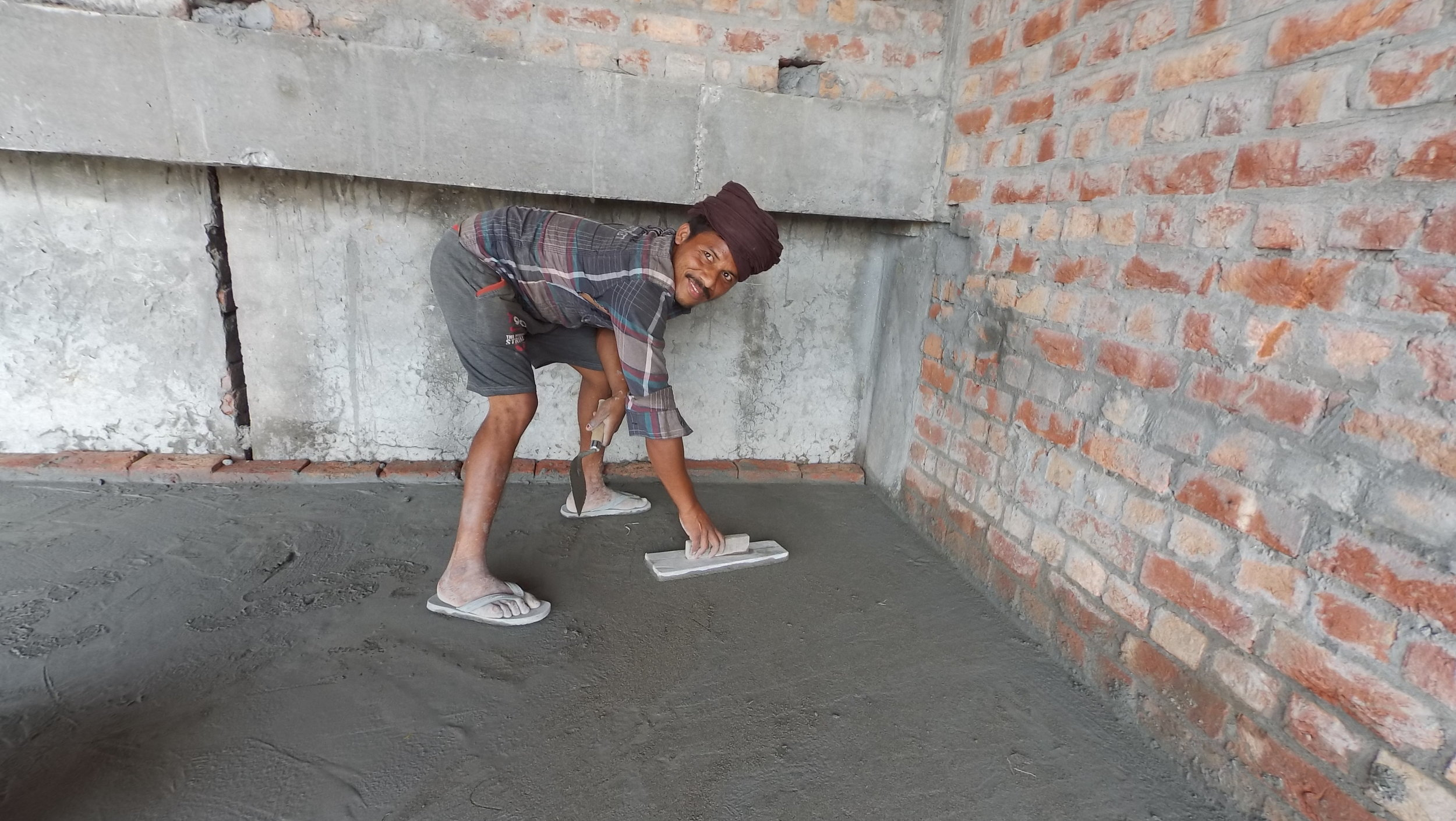Labourer polishing the floor at gurdwara before his departure, 1 June 2016