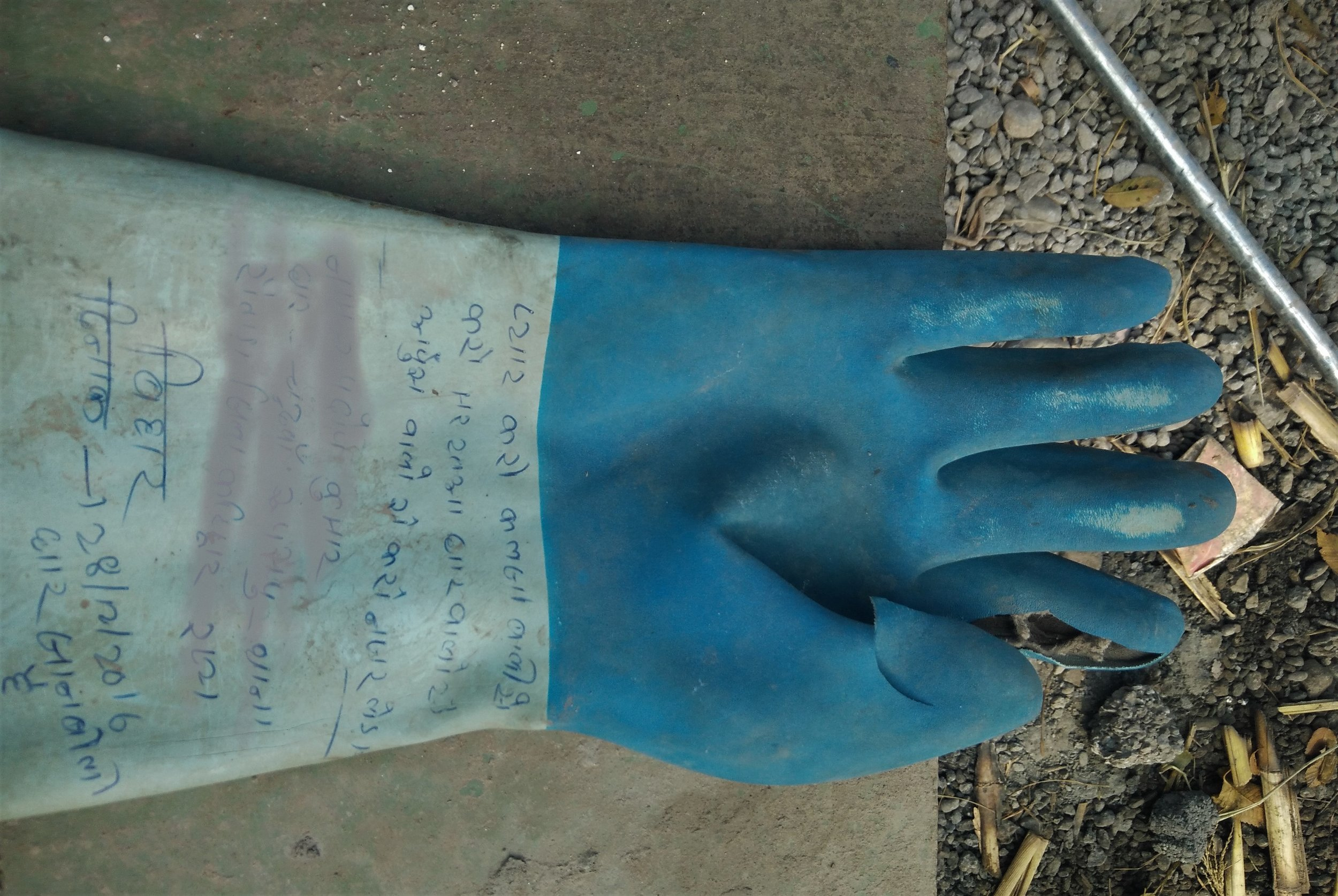 A migrant worker wrote a piece of poetry about women on his safety glove. Credit: Ankur Jayaswal