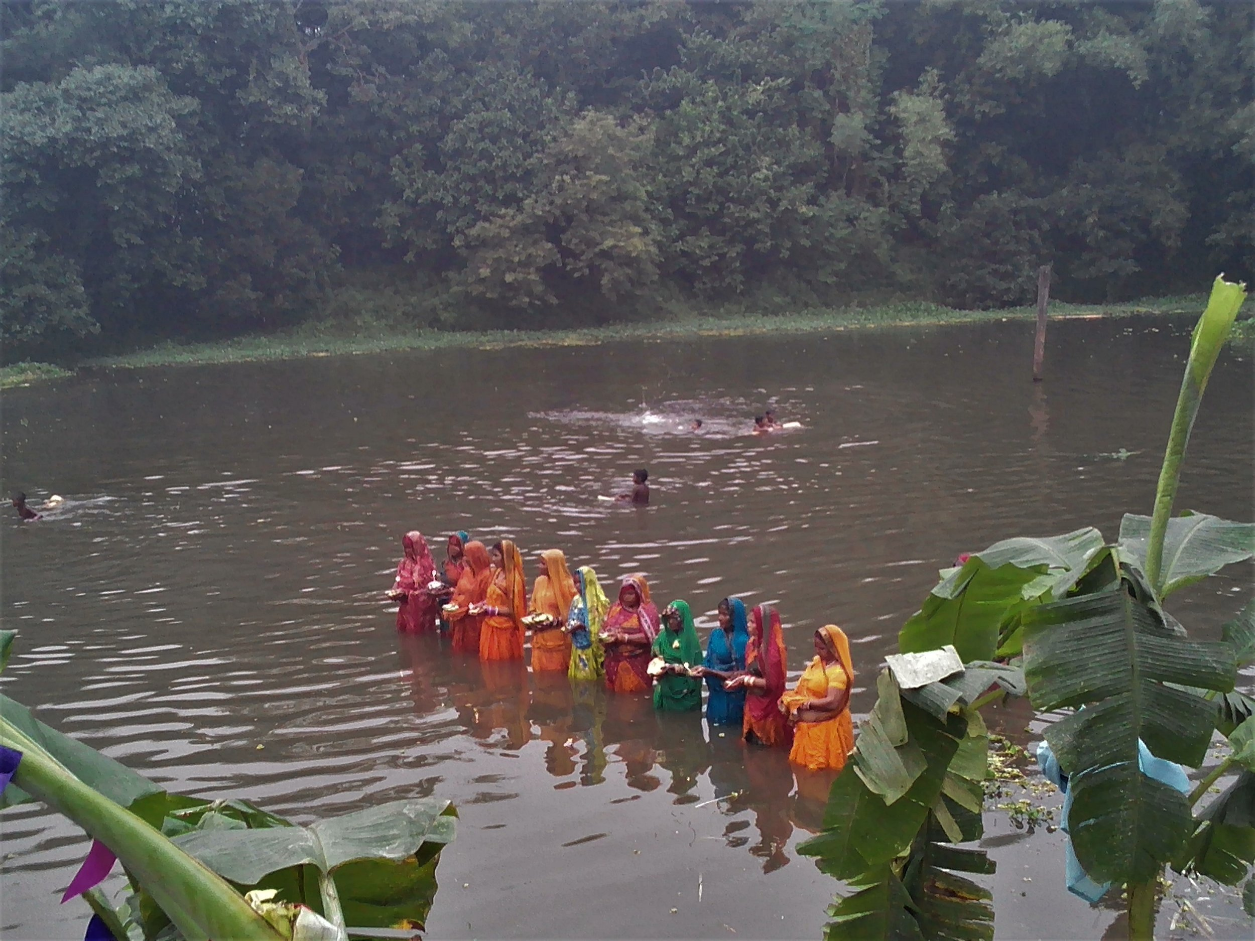 Women of a village in Araria observes Chhath prayer in the evening. Credit: Zaheeb Ajmal