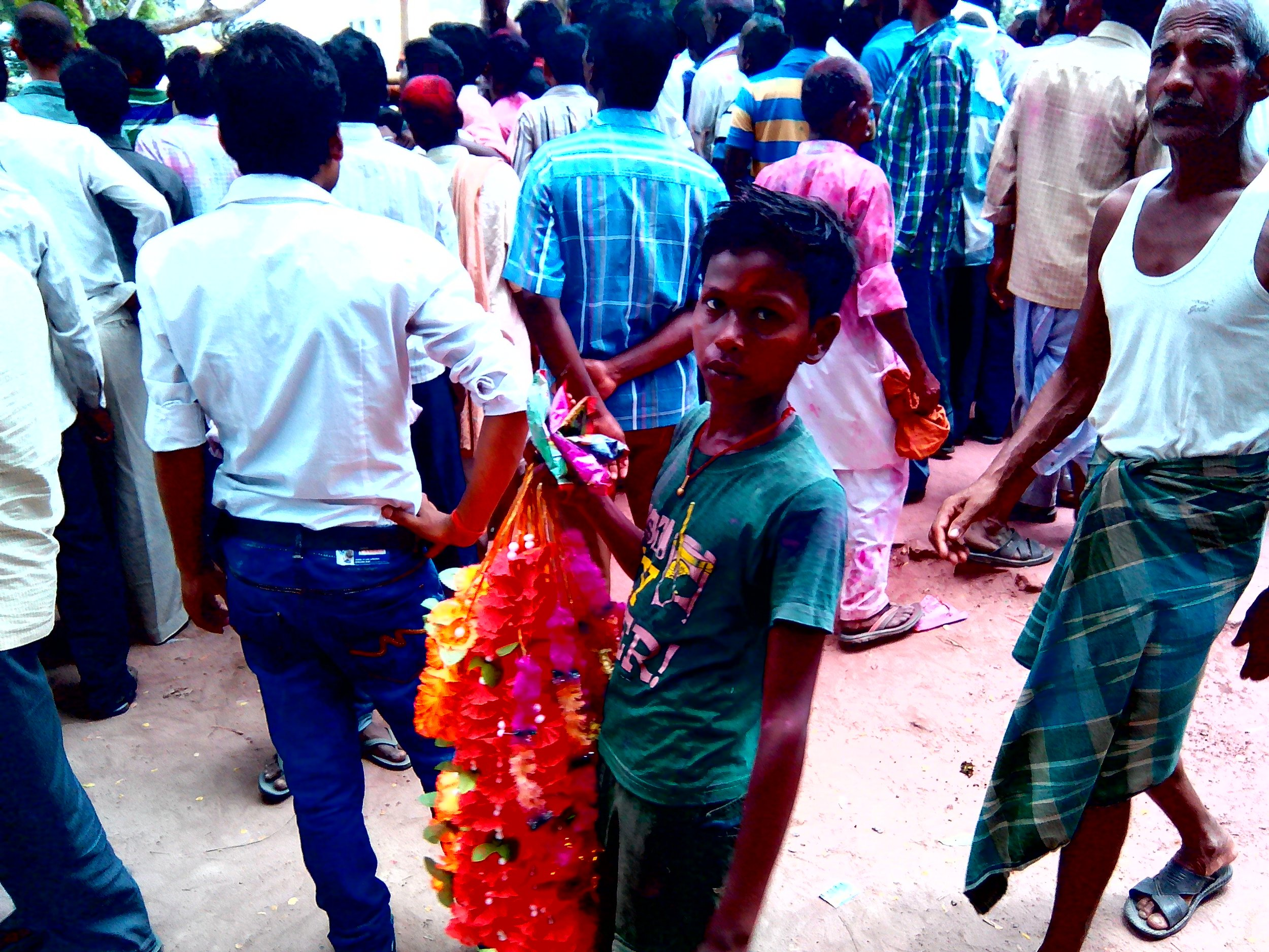 A boy sells garlands and gulal as the results are being declared for the village level elections. Credit: Zaheeb Ajmal