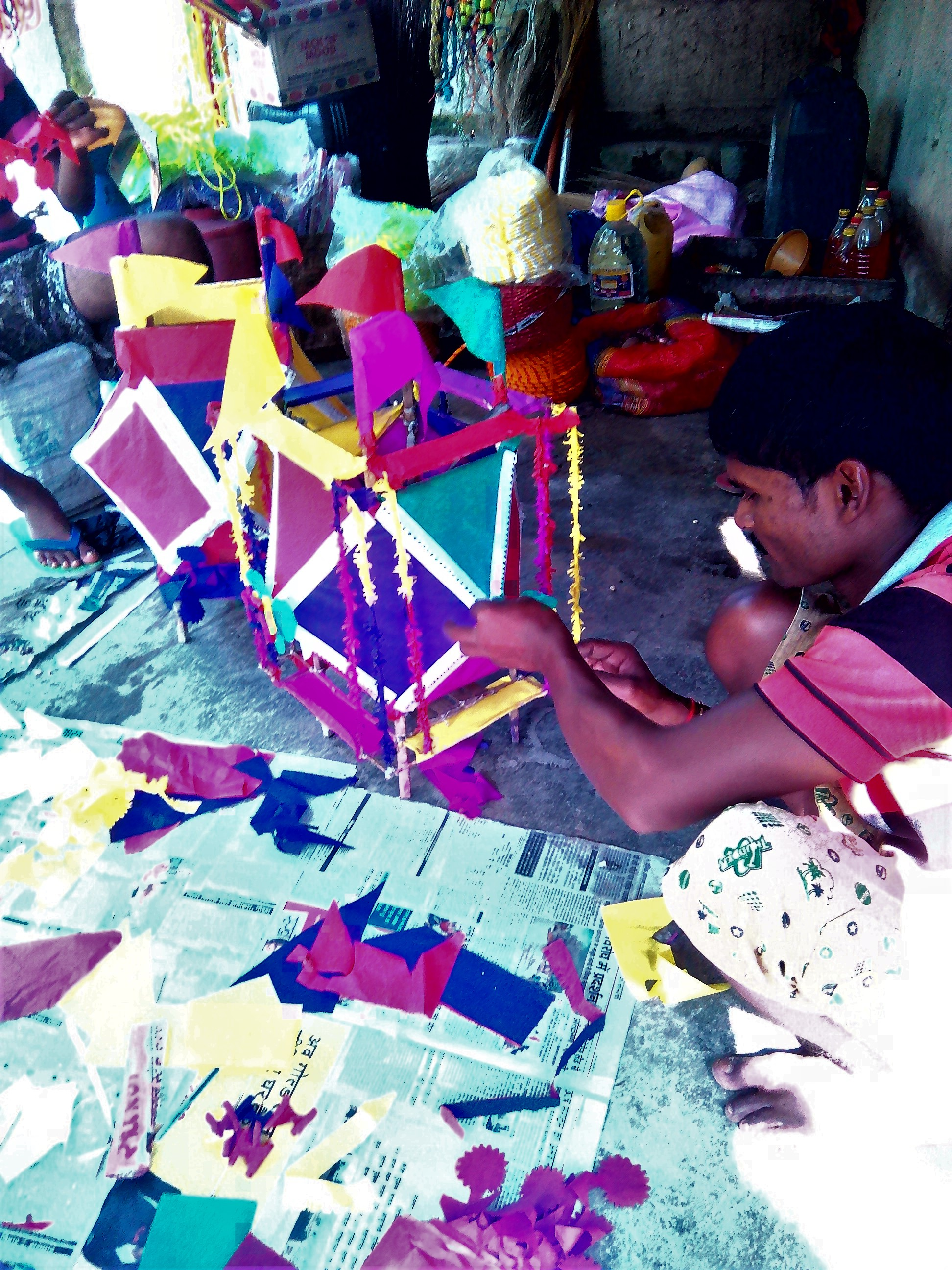 A shopkeeper in a village in Araria makes decorative pieces called 'Kandil' using colourful papers. Credit: Zaheeb Ajmal