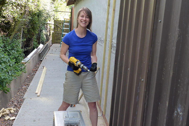 Abbie reusing the old stable cladding at the back of the distillery