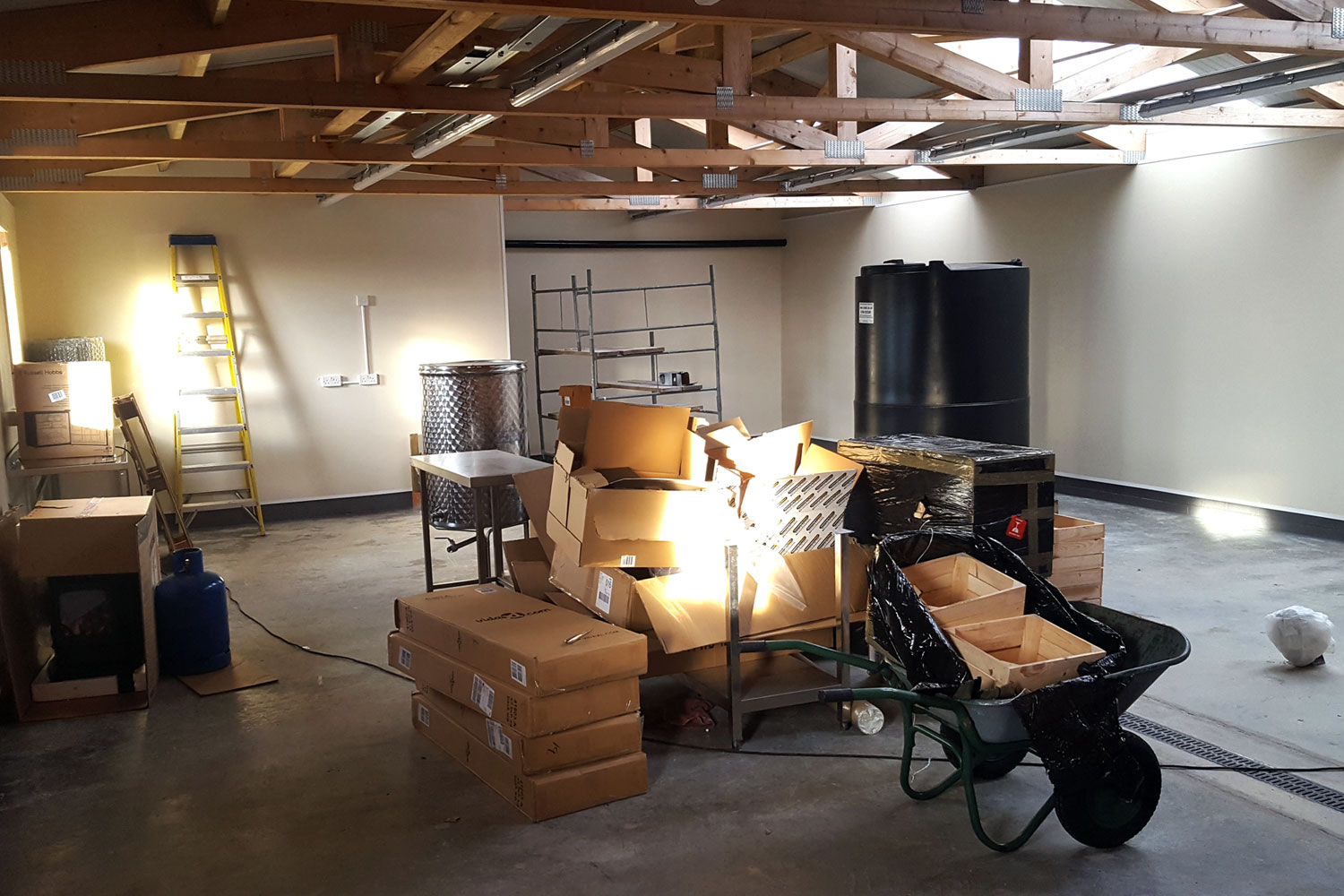 Starting to move equipment onto the distillery floor.