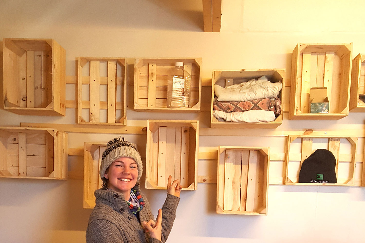Elle with her timber boxes hung in the Tasting Room.