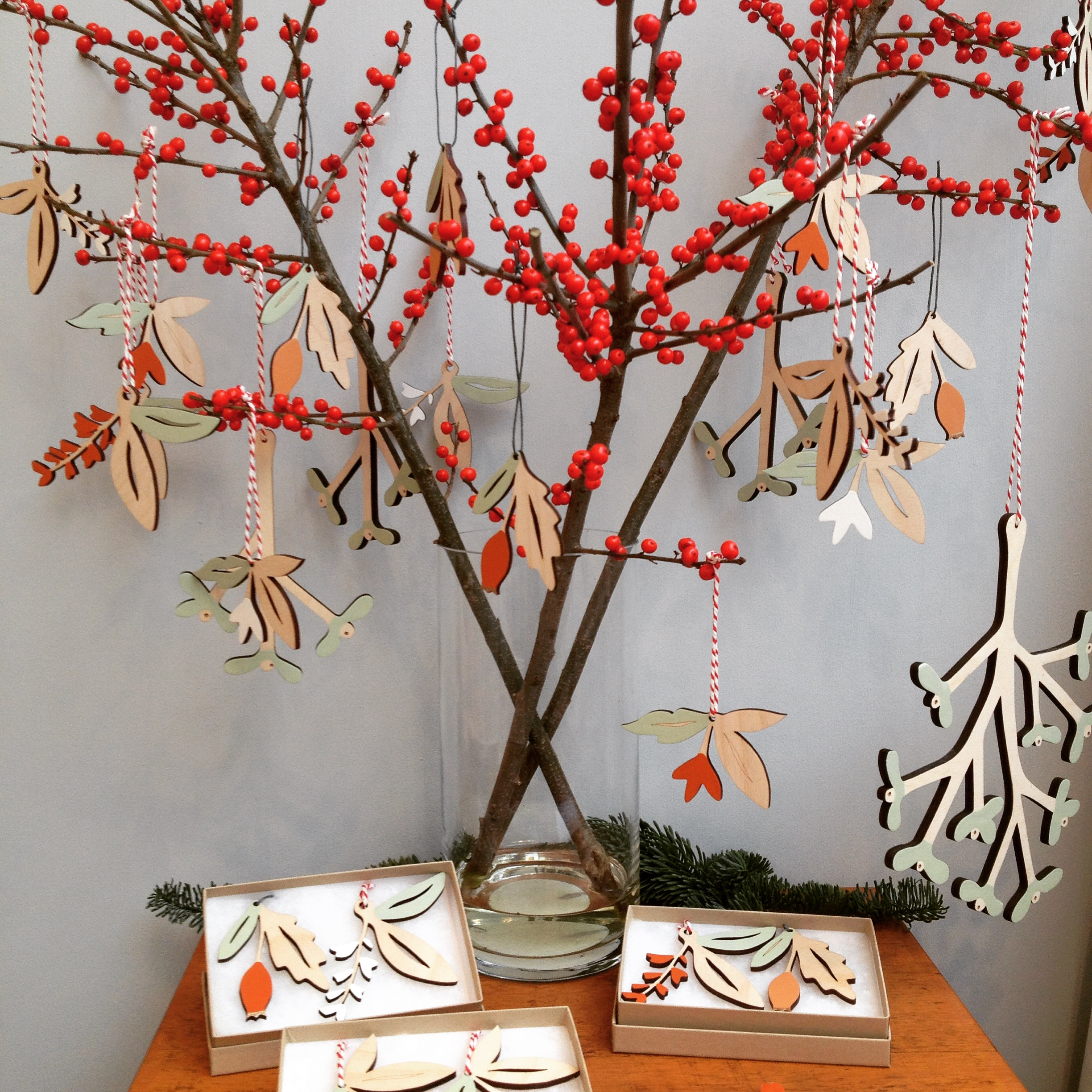 Style your wooden decorations with winter berries for beautiful effect.