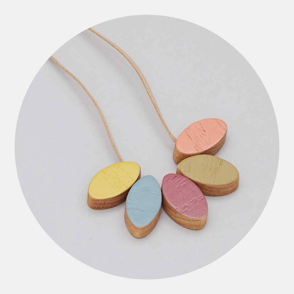 Plum Petal Necklace - Make a statement with this bold, yet elegant wooden necklace in the colours of summer.The light and easy-to-wear short style can also be lengthened to achieve the perfect fit whatever your outfit.