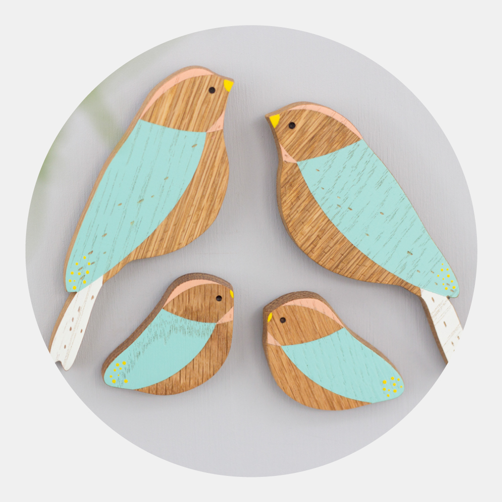 Wooden Wall Birds - Family Set - Hand-crafted wooden birds to hang on the wall and brighten up the home. Available in two colour ways, as a family or in pairs.Delightful gifts to celebrate a wedding or anniversary.