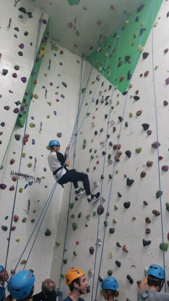 Students navigate the climbing wall