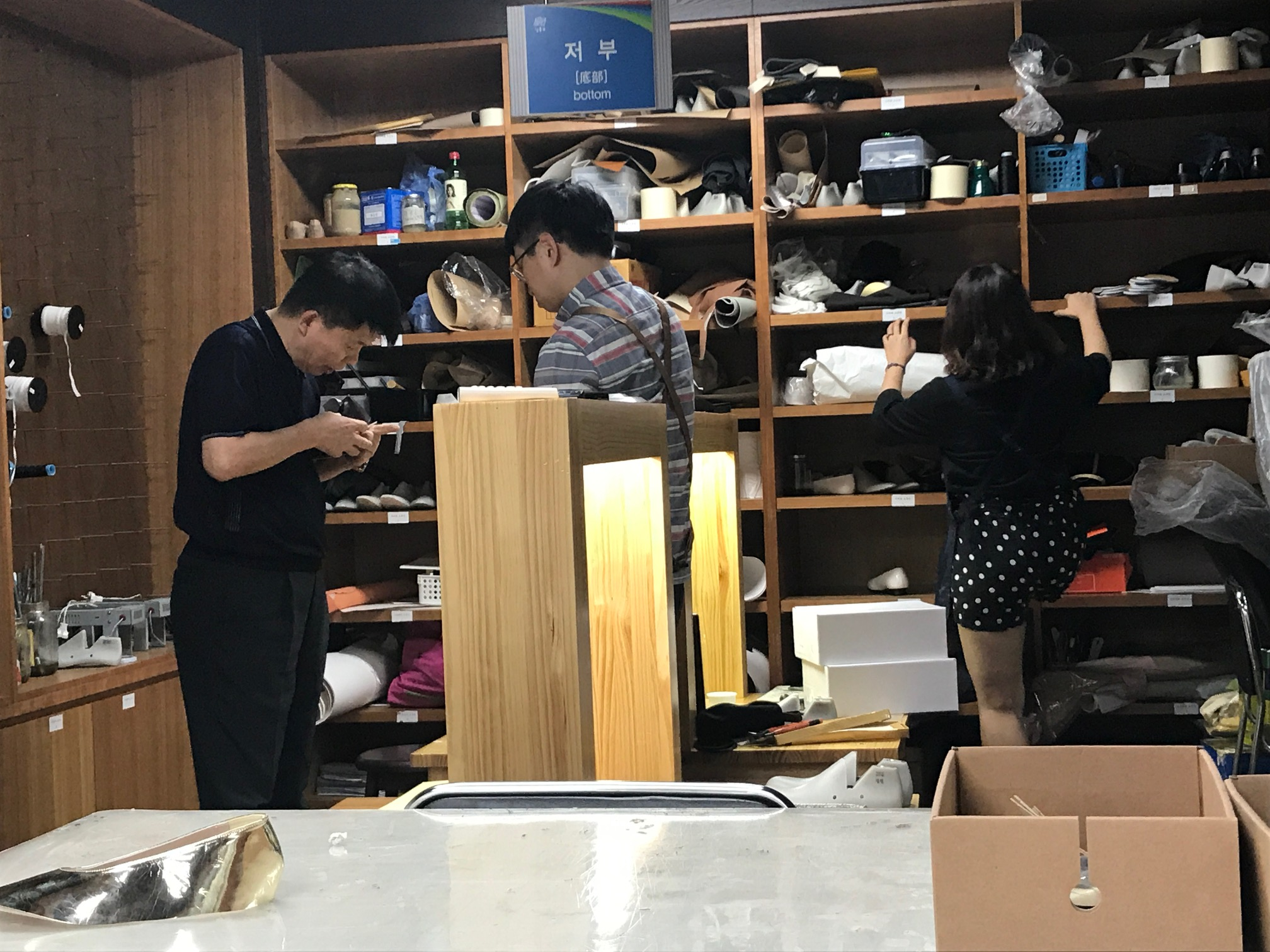 The man in far right corner teaches the students, and he is truly an expert. He can make 1 pair of shoes in 1 hour, averaging about 15 shoes per day. He's been hand-making shoes for 30 years!