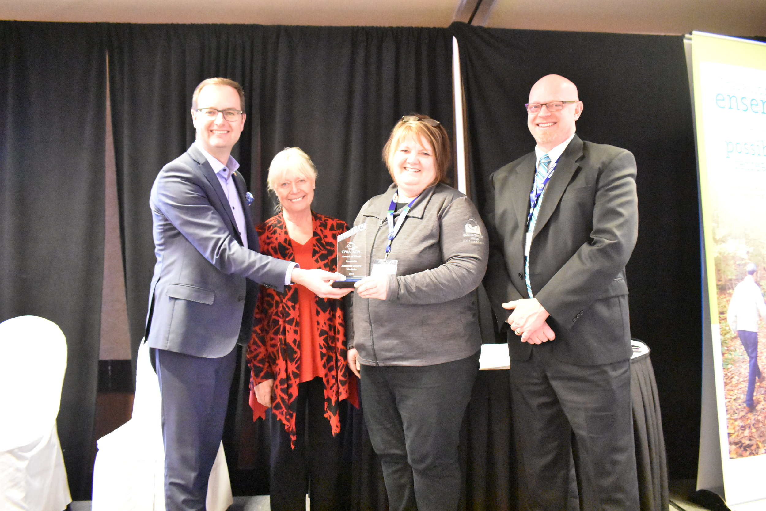 2016 CPRA Award of Merit recipient Susanne Moore, Manitoba with CPRA Board representative Ron Epp (r) and RCM Board Members