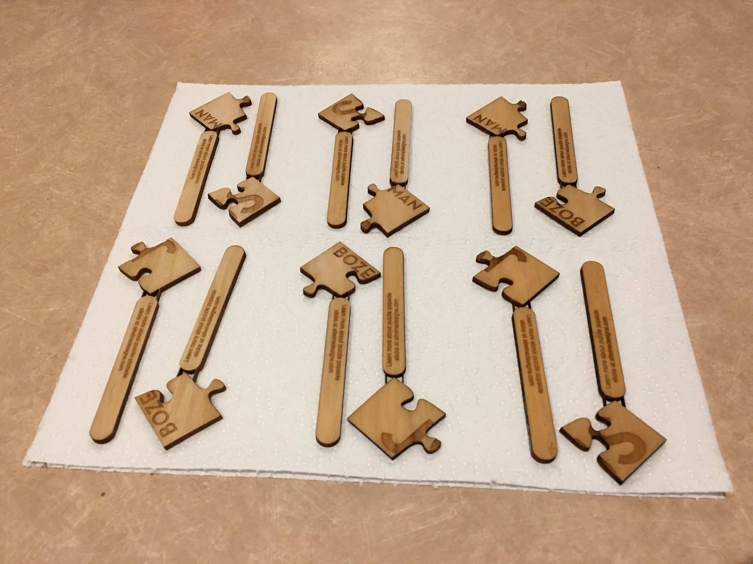 Drying the popsicle sticks after boiling them.
