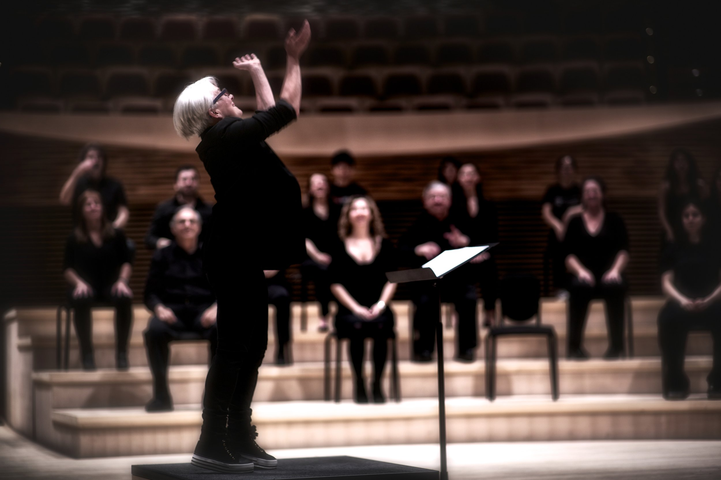 """Ann Carlson """"conducting"""" the Symphonic Body / Stanford. Photo by Jamie Lyons"""