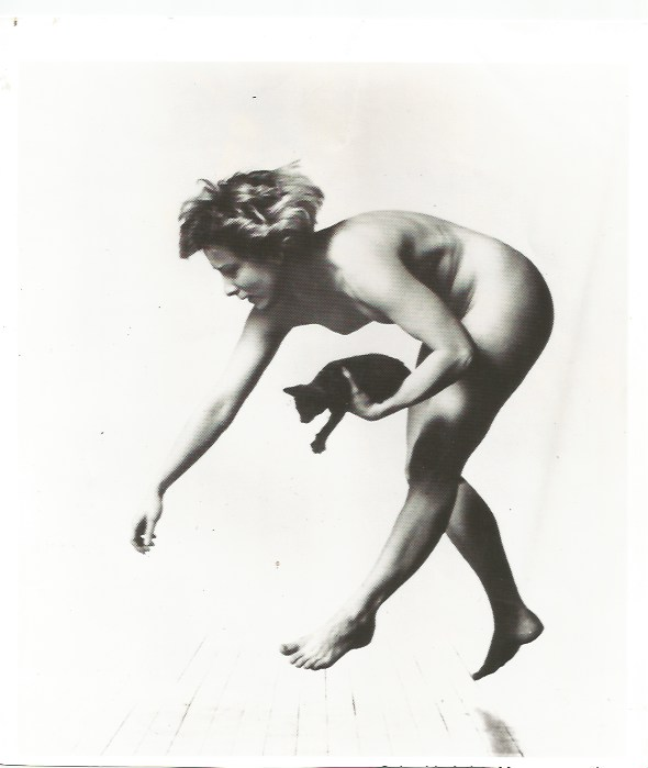 """Ann Carlson and kitten in """"Visit Woman Move Story cat cat cat"""" photo by Lois Greenfield"""