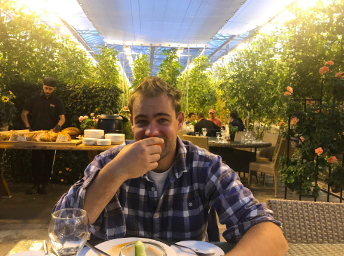 Me enjoying some tomato schapps after some tomato soup surrounded by tomato plants.