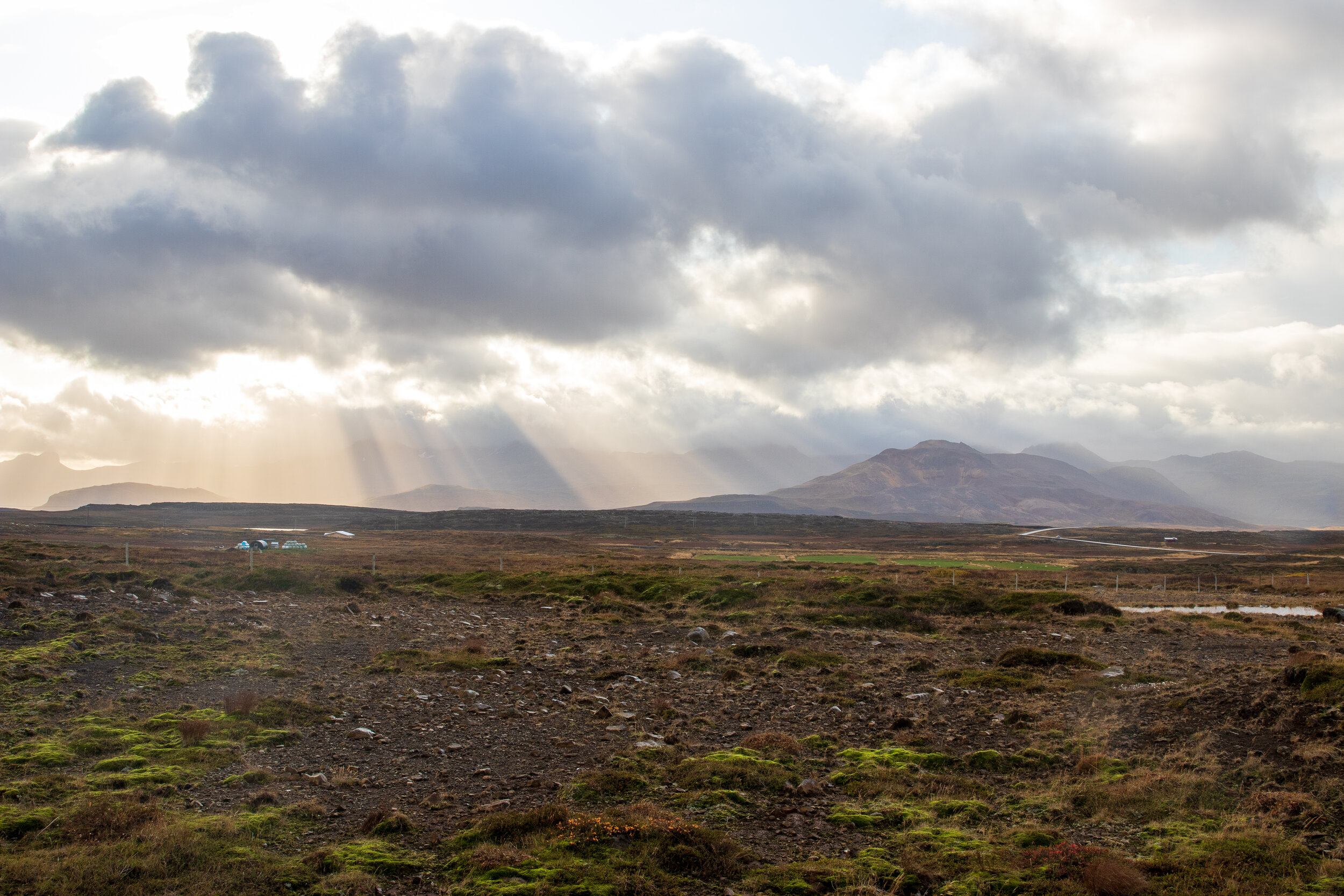 Rays of sun passing through the clouds on the mountains south of Stykkishólmur.