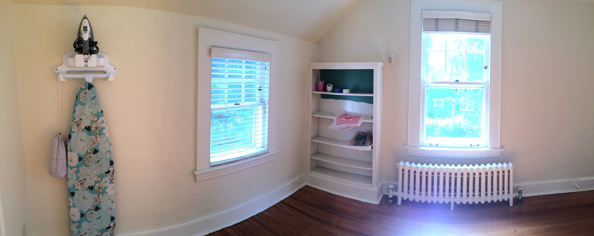 """The """"BEFORE"""".Current panoramic view of the room. Right now it has nothing going on, short of a paint sample I tested in the built in! This space is sad. It needs way more than a facelift, it needs an entire overhaul."""