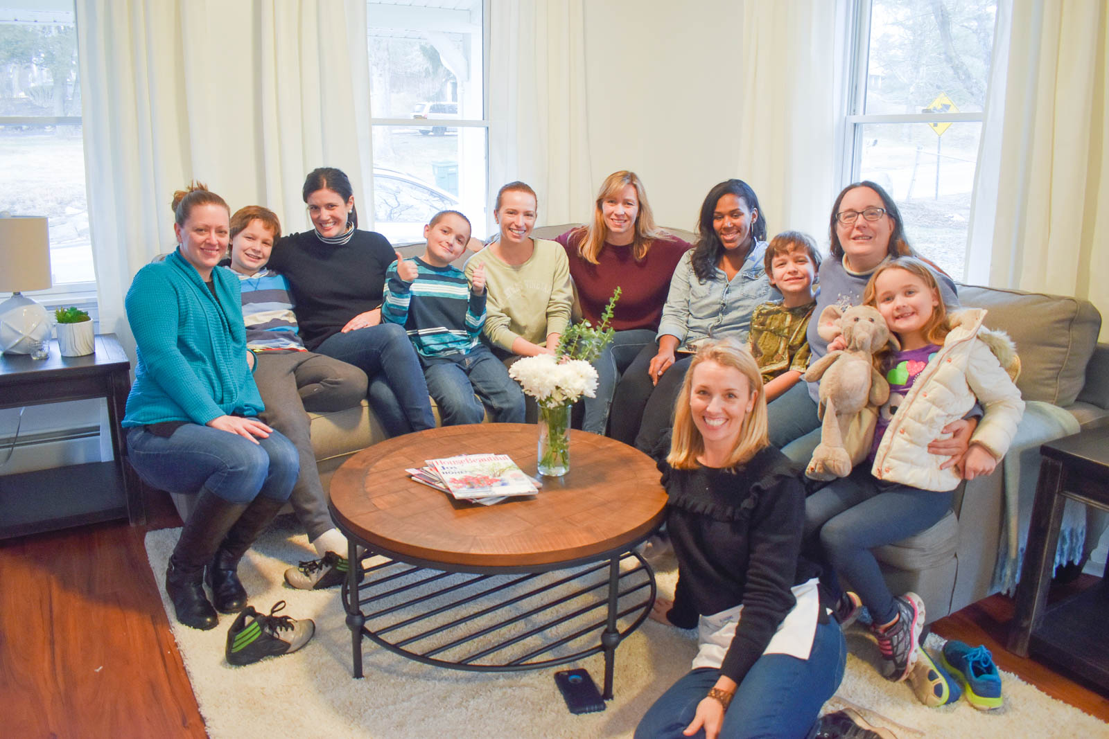 The whole BHH crew, along with the Family enjoying their new home!  Image Courtesy of  Charlotte Smith