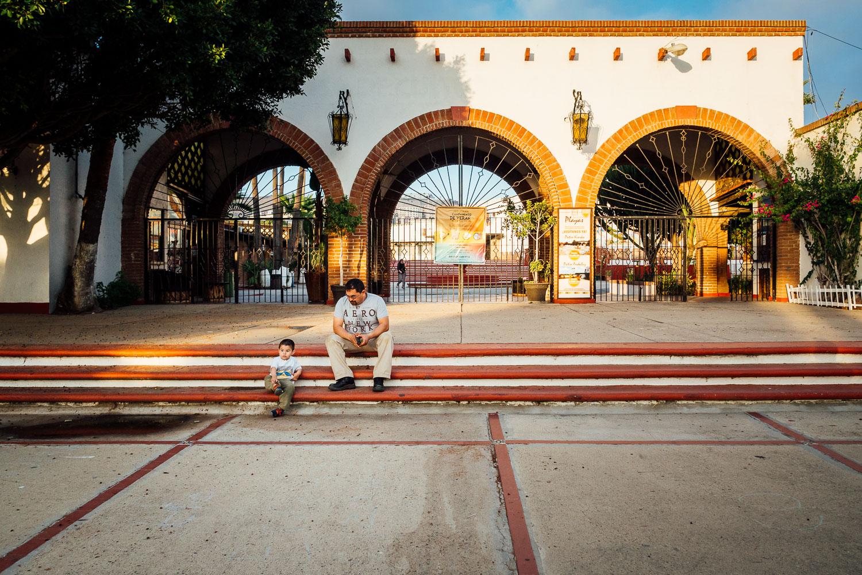 Tijuana-Mexico-Cultural-Center-Man-Boy-Sitting.jpg