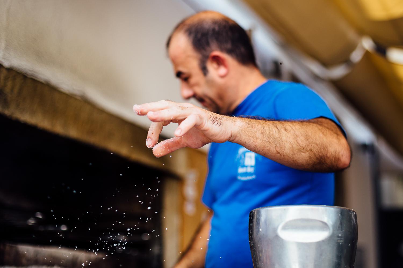 Cooking-Fish-Artesanal-Couisine-Salt-Sprinkle-Portugal-Travel-Photography