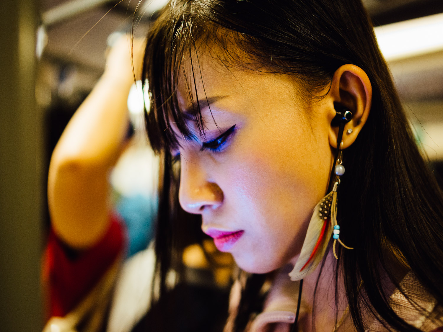 I took this photo on Bangkok's Sky Train. This woman never realized that I made an image of her, and I doubt she ever will.