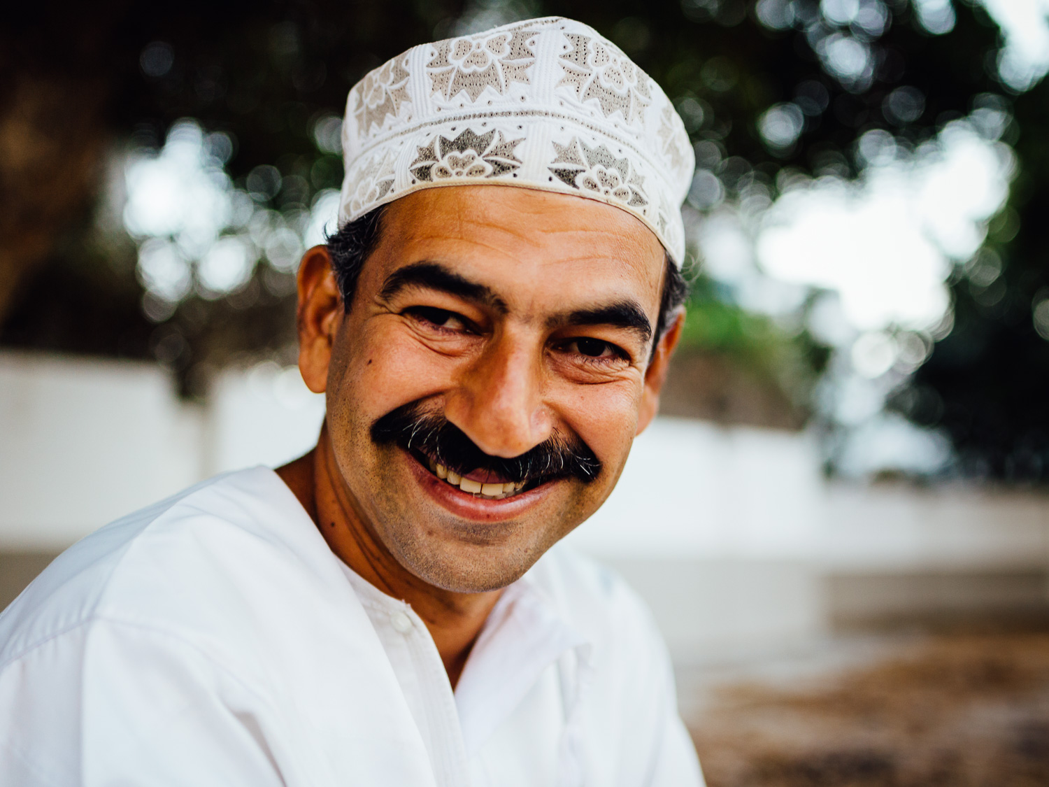 I met Mohammed at the beach. Our interaction was brief, and superficial. But somehow, for some reason, he gave me a full-faced genuine smile. I'm glad I captured it.