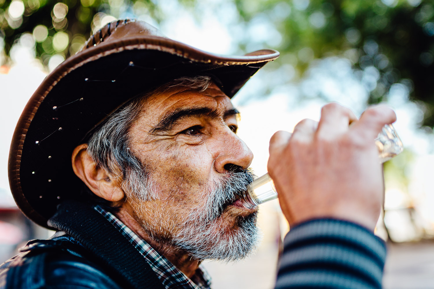 Man-Homeless-Drinking-Tequila-Mexico-Durazo-Photography
