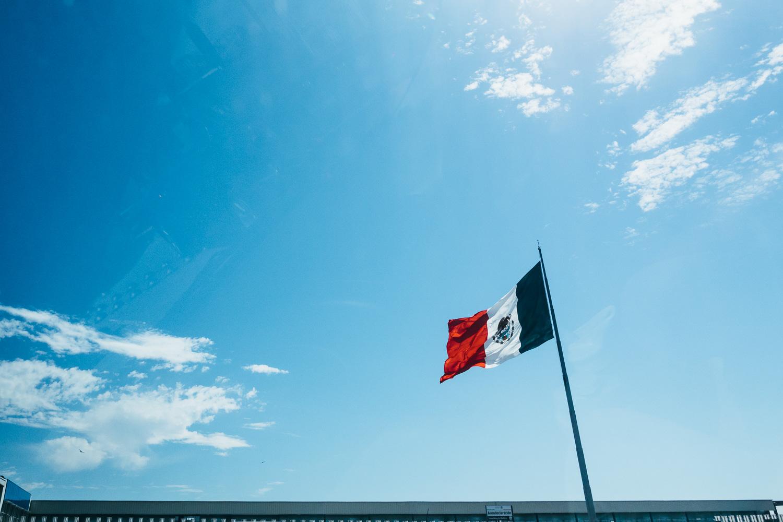 Tijuana-Mexico-Border-Flag-Blue-Sky.jpg