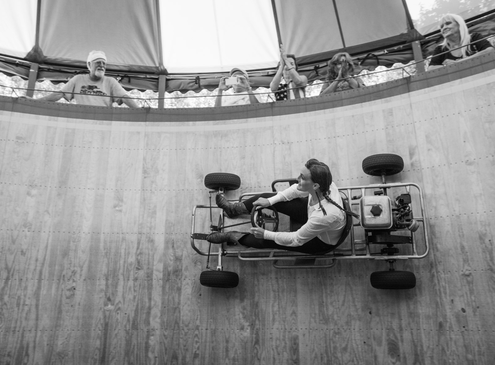 Samantha Stardust puts some rubber on the walls, taking the Wild Wheels racing go kart up for a spin.