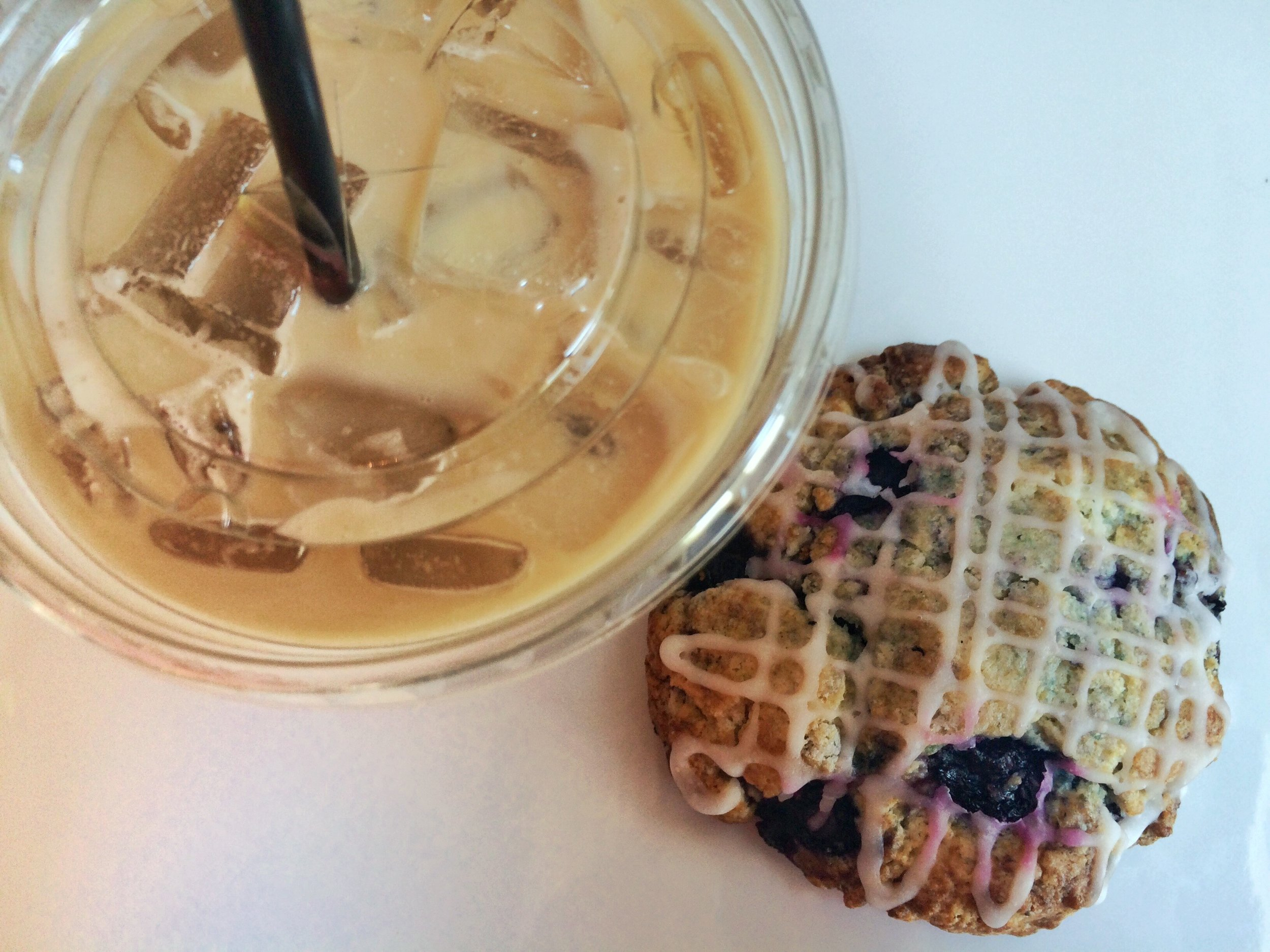 A Homemade Blueberry Scone with an Iced Signature Caramel Latte