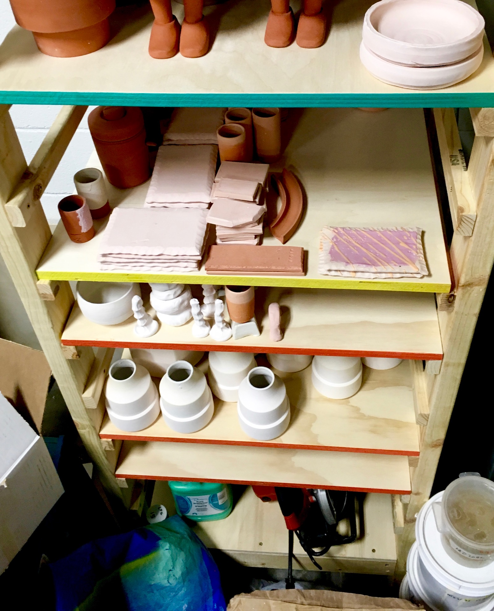 The finished rack. The shelves can be positioned to fit the height of the work. The edge colors indicate what cone of the work on that shelf.