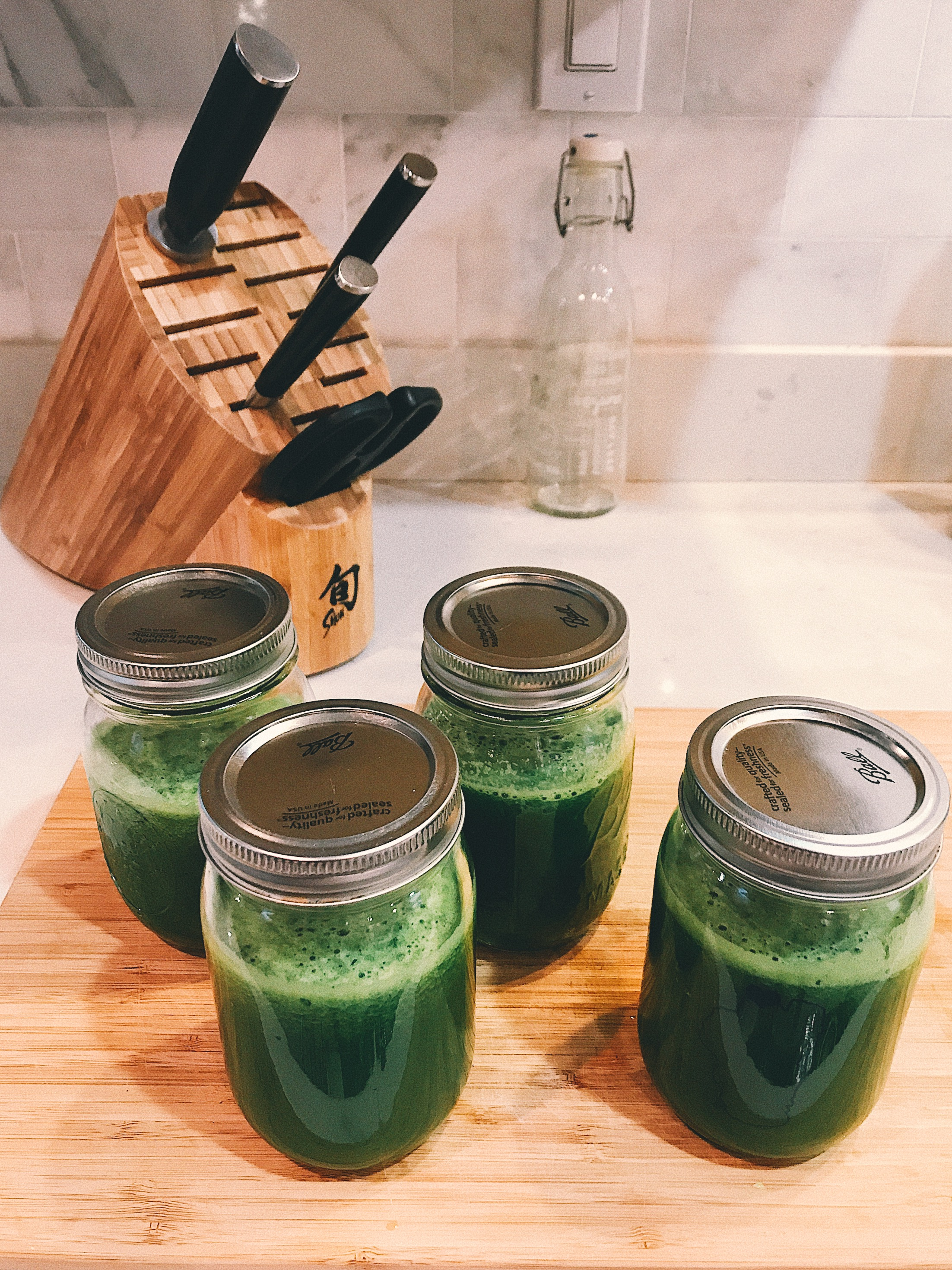 Our daily juice: spinach, kale, romaine, lime, celery, cucumber.