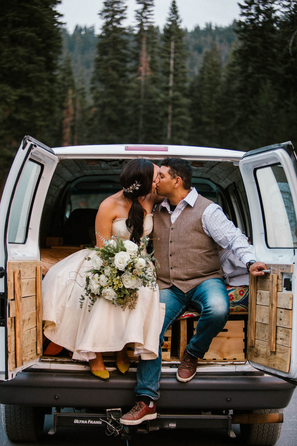 The Bride and Groom with their DIY camper van.