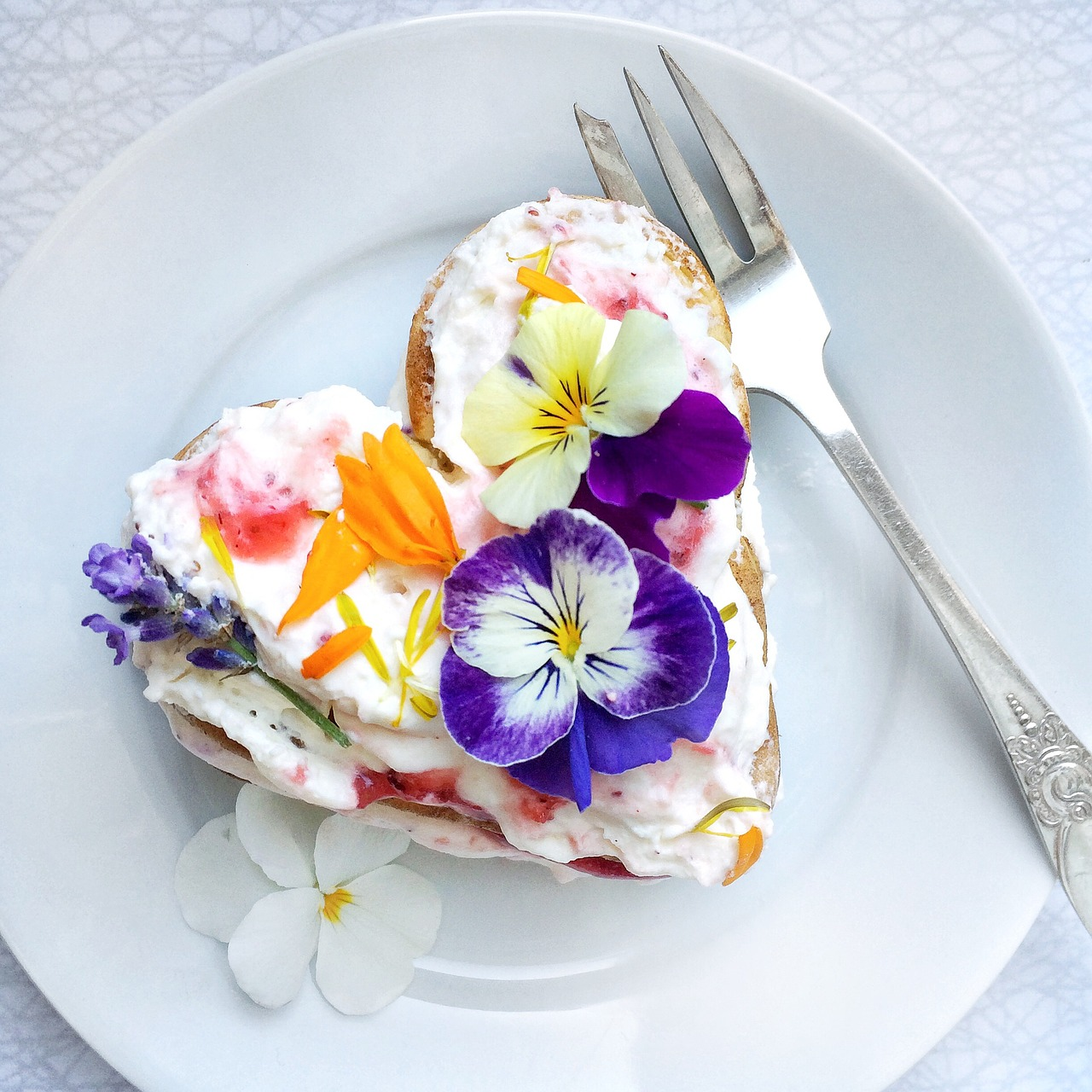 Layer jam and top with whipped cream and edible flowers for WOW factor,